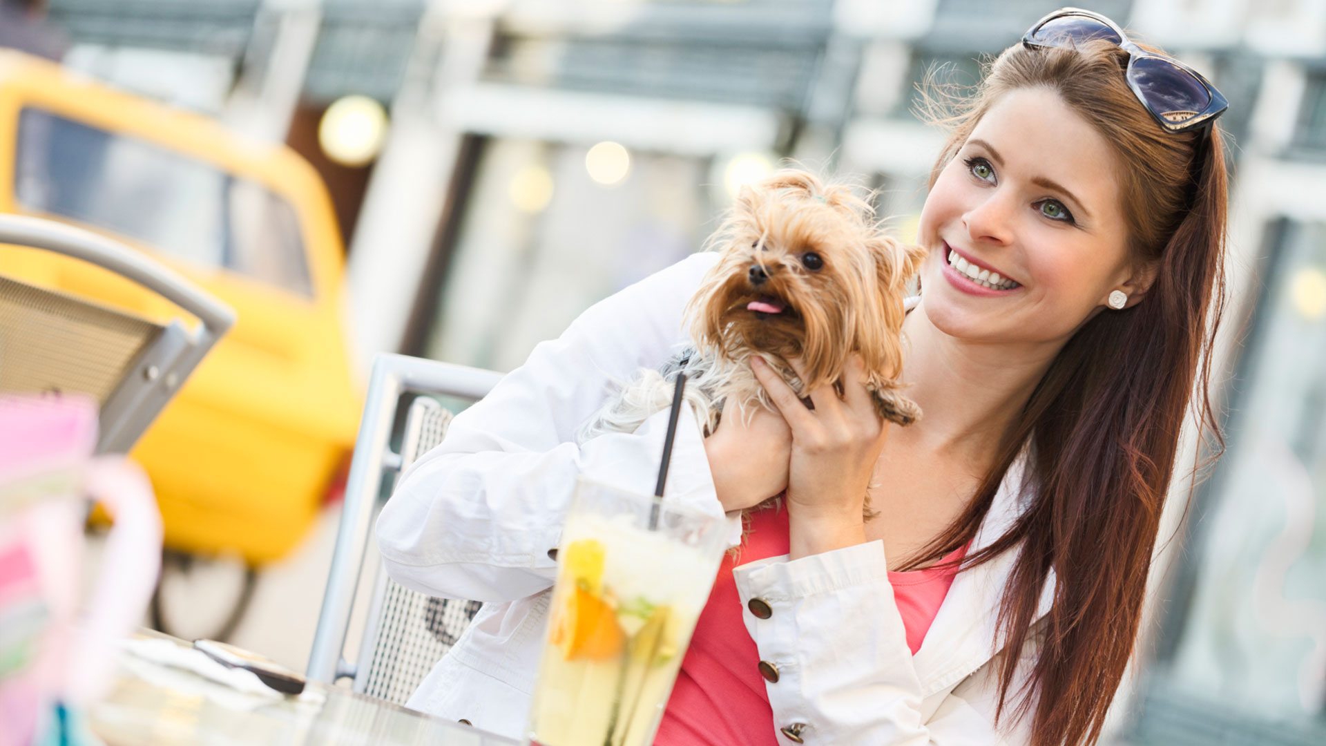 Woman at outdoor cafe with dog