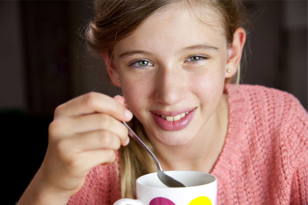 Young Girl eating soup