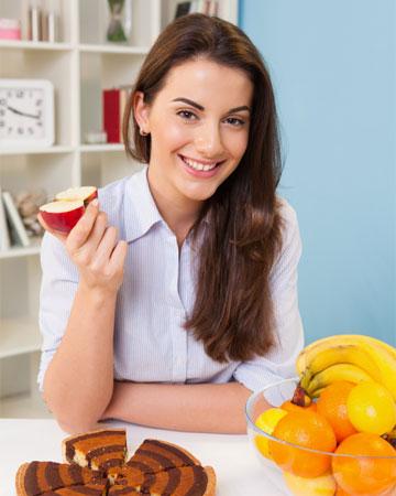 Yound woman having breakfast