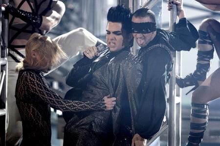 Adam Lambert performing on the November 22 American Music Awards