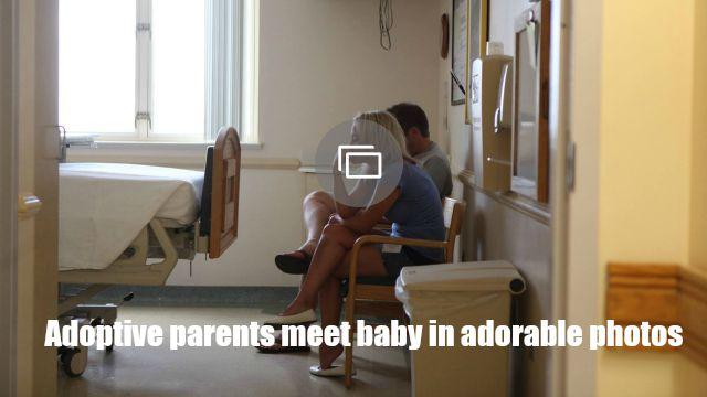 adoptive parents meet baby