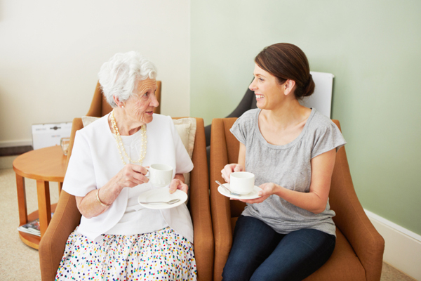 Adult granddaughter visiting with grandmother