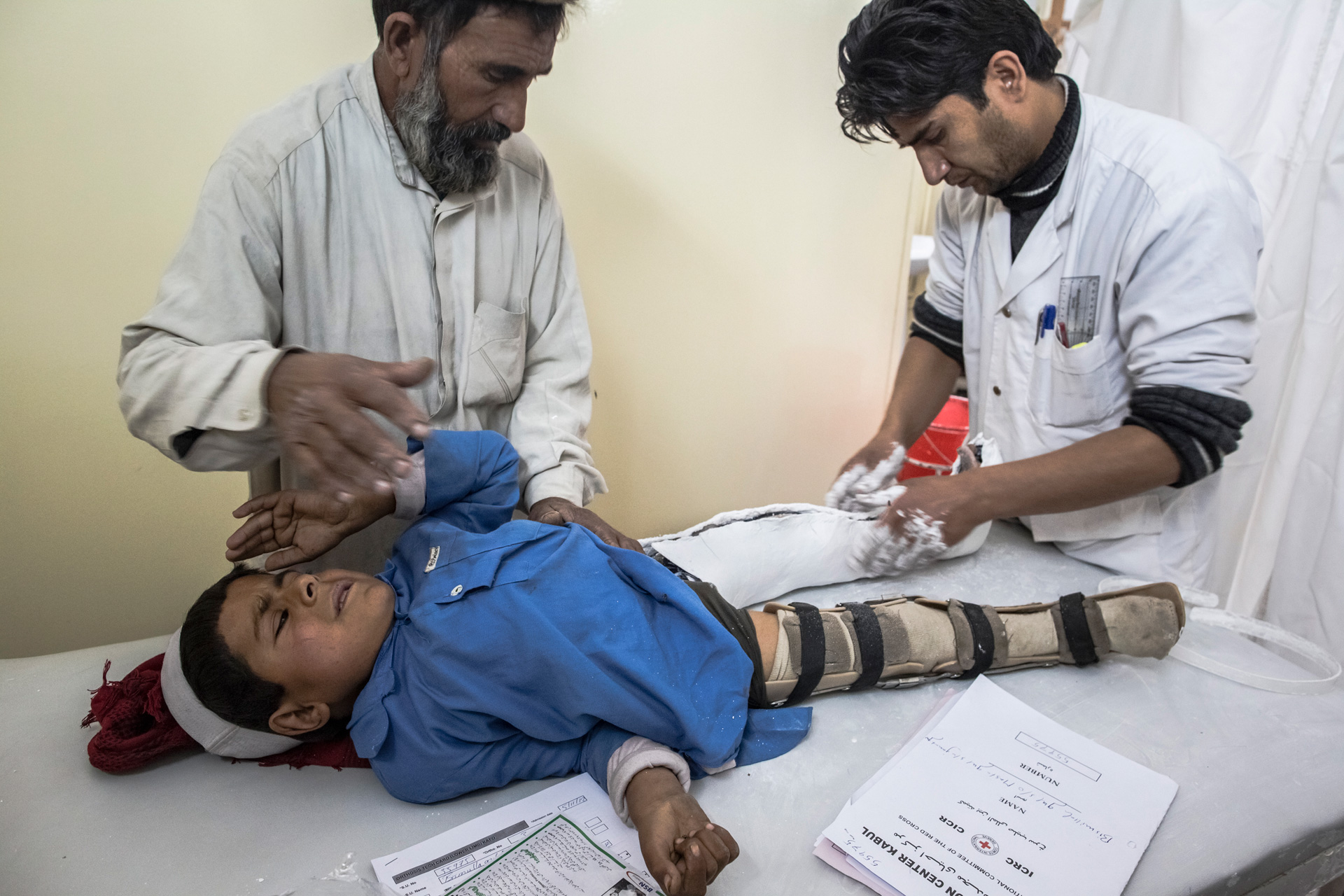 A young boy suffering from polio receives treatment in Kabul, Afghanistan