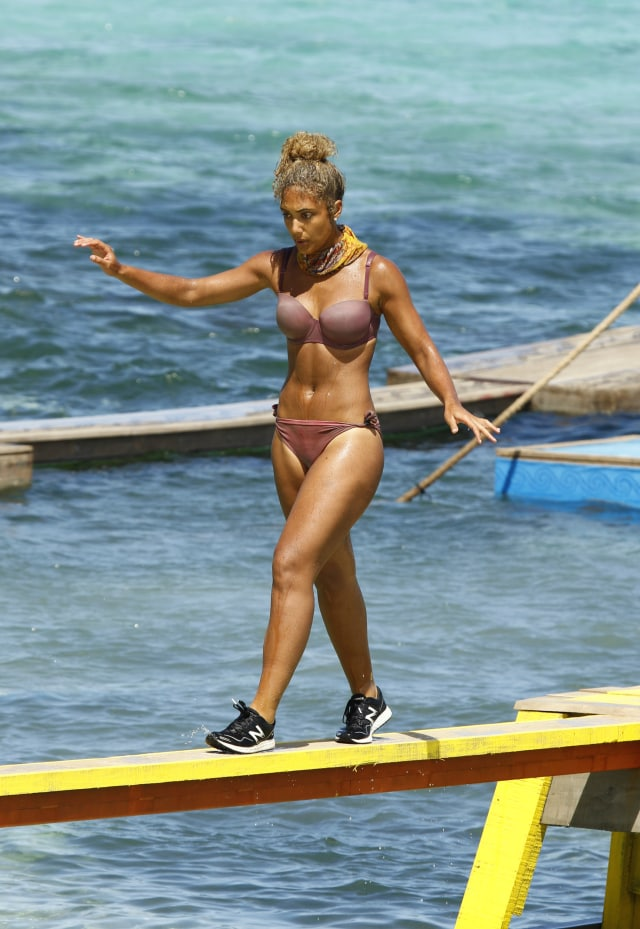 Ali Elliott competes in balance beam challenge on Survivor: Heroes Vs. Healers Vs. Hustlers