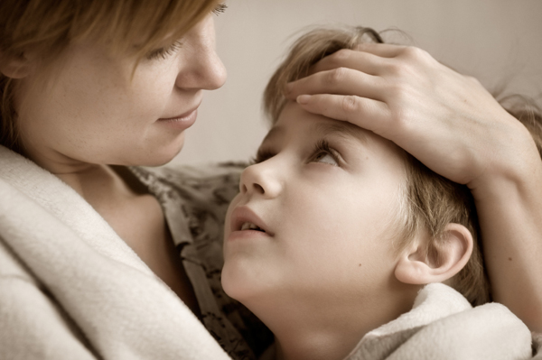 Mom Holding Sick Child