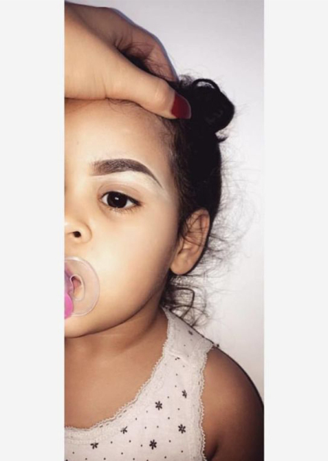 Toddler with drawn in eyebrows