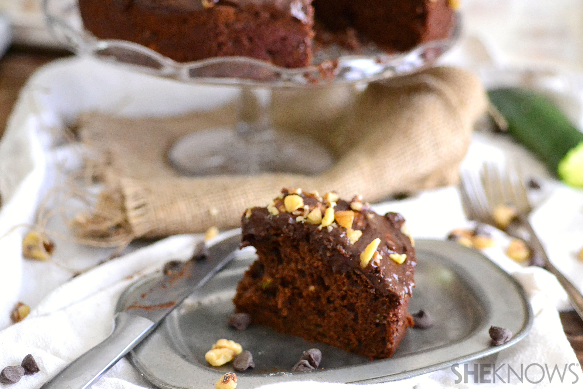Fudge, peanut butter and zucchini cake with rich avocado frosting