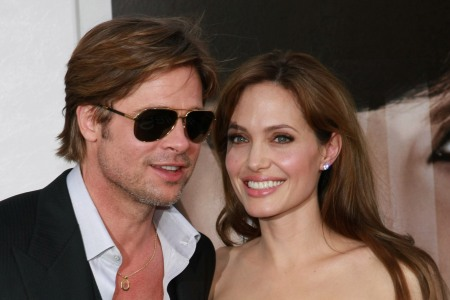 Brad Pitt supports Angelina Jolie on the premiere red carpet for Salt