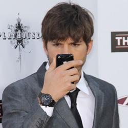 Ashton Kutcher on cell phone