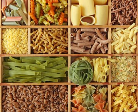 Assortment of pasta varieties in a wood organizer