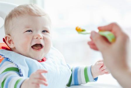 Baby eating organic food