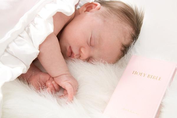 Baby girl near bible