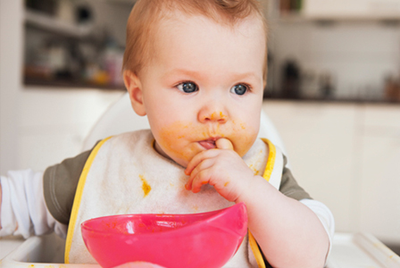 Baby with food on face   Sheknows.com