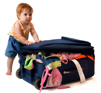Baby with suitcase packed