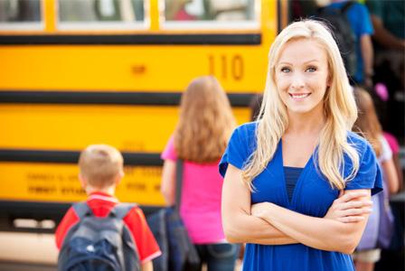 Mom in front of school bus