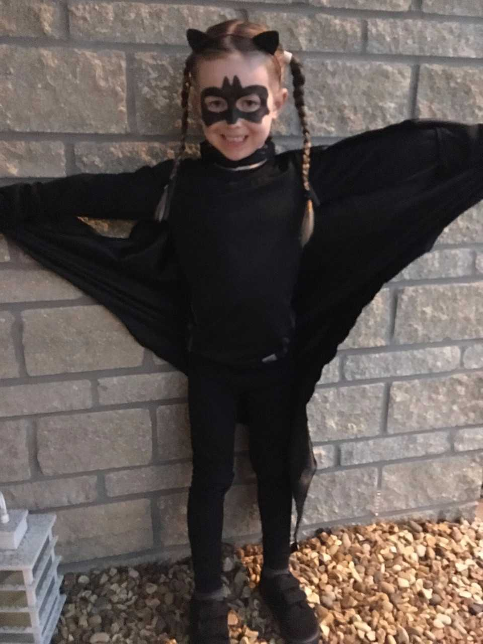 Girl dressed as a bat for Halloween - What's with sexy costumes for kids?