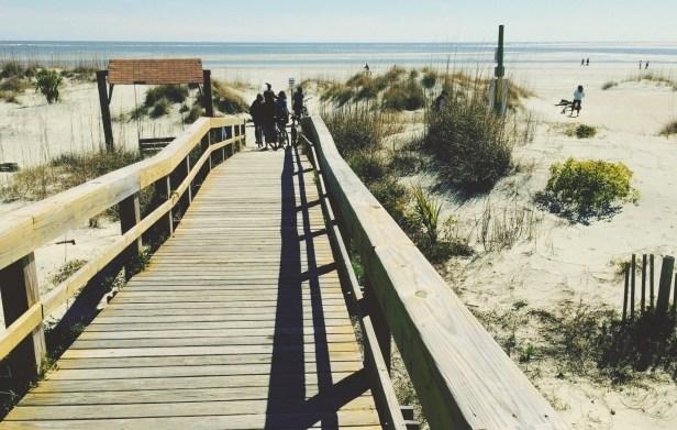 Wooden Walkway On Beach Against Sky