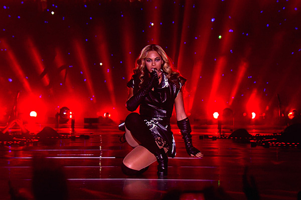 Beyonce performing at the Super Bowl wearing leather and lace