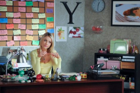 Katrina Bowden at her 30 Rock desk