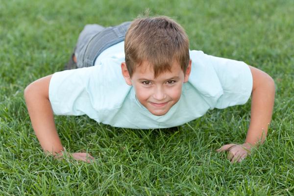 Boy doing push ups