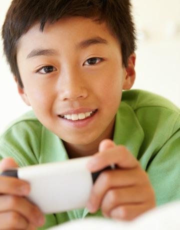 Boy using iPhone