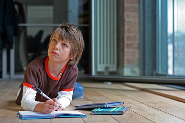 Boy writting in journal