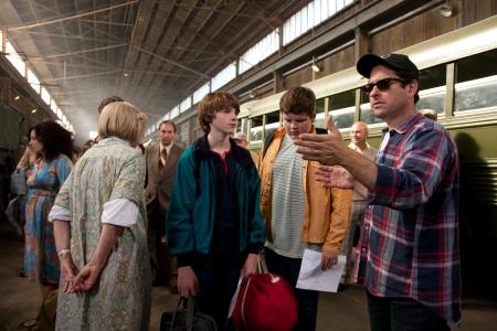 The boys of Super 8 listen to director J.J. Abrams on set