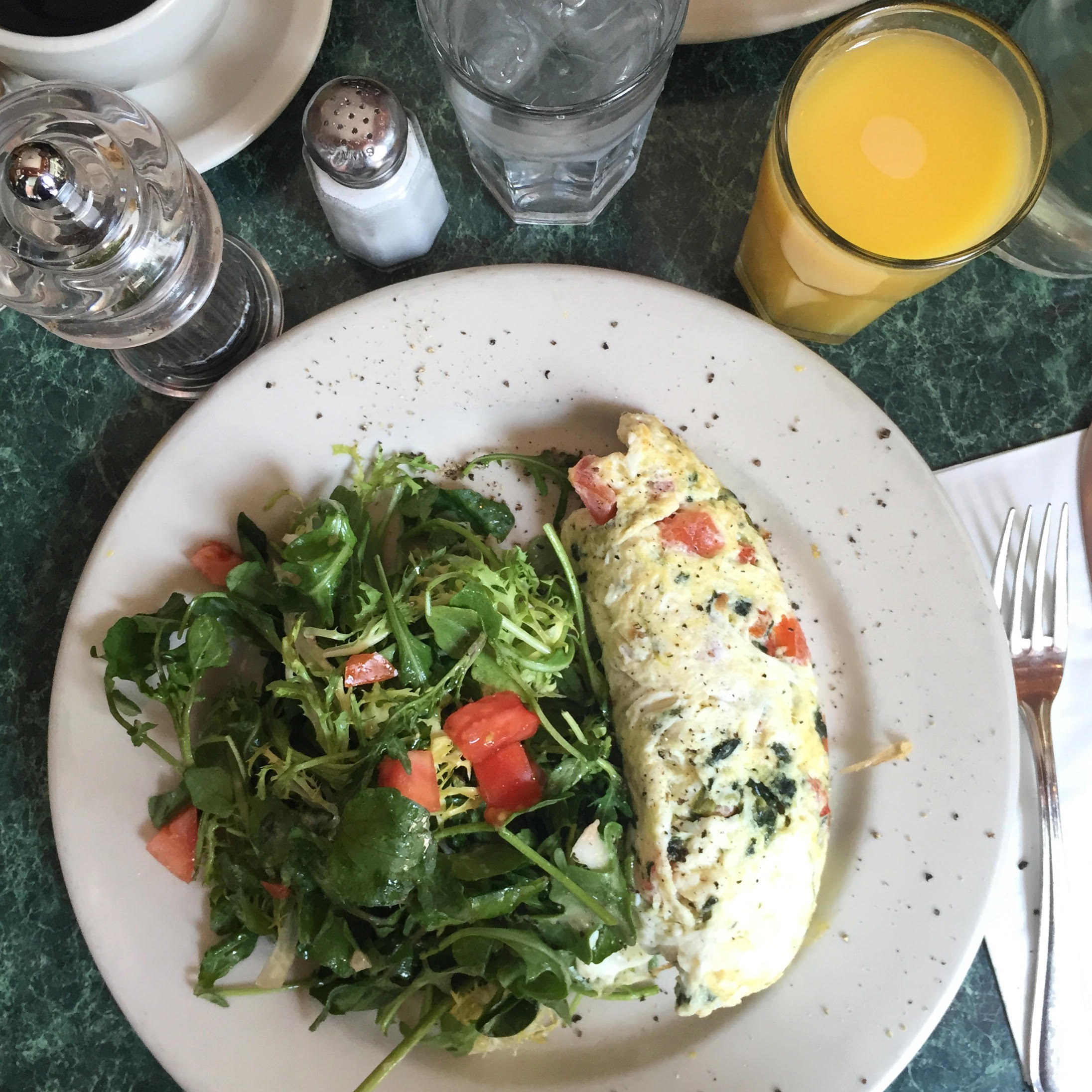 omelette with salad and orange juice