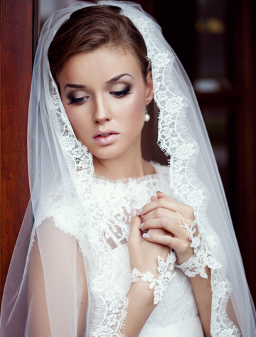 Bride wearing romantic veil