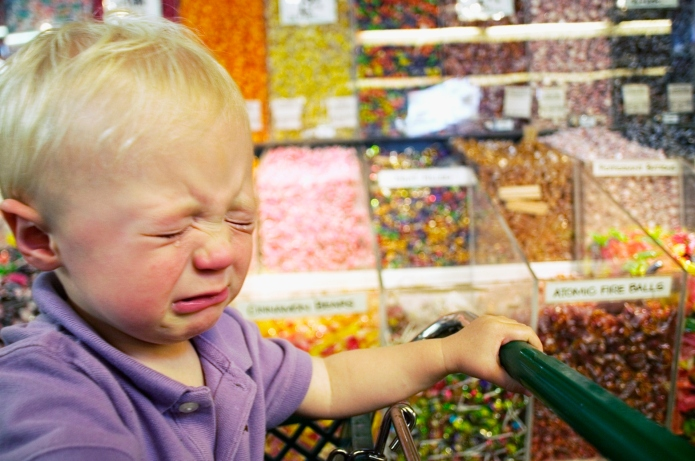 Baby boy crying in candy aisle