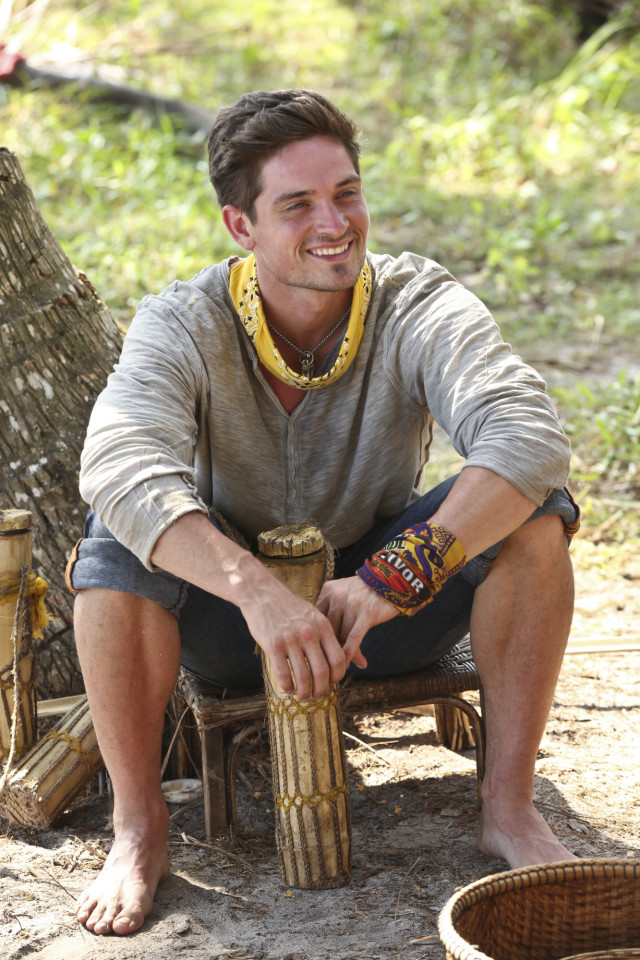 Caleb Reynolds sits at Beauty tribe's camp