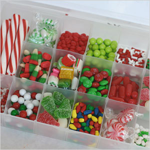 Use candy containers for decorating the gingerbread house | Sheknows.com
