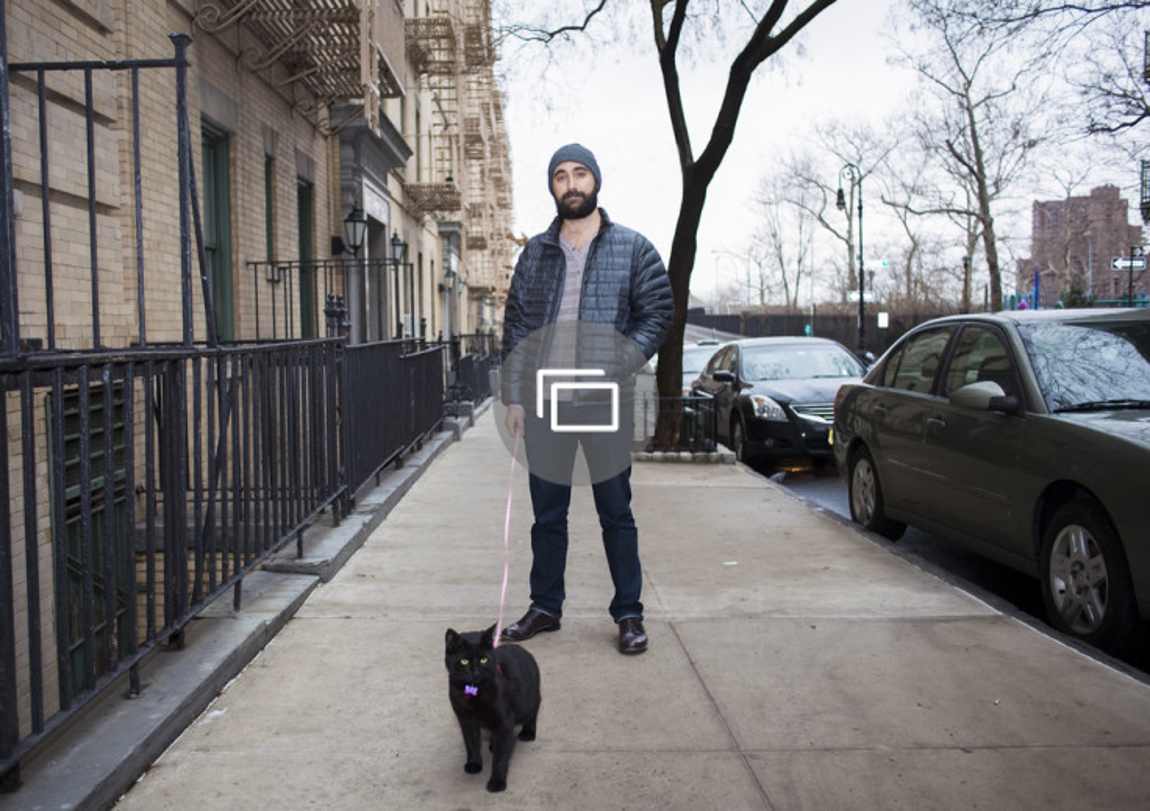 Photo series proves cat can be man's best friend too