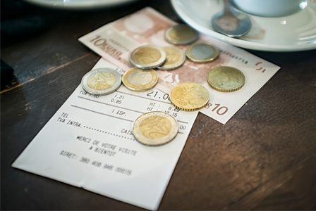 Cafe bill being paid for with Euros
