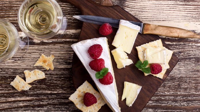 Cheese board with white wine and