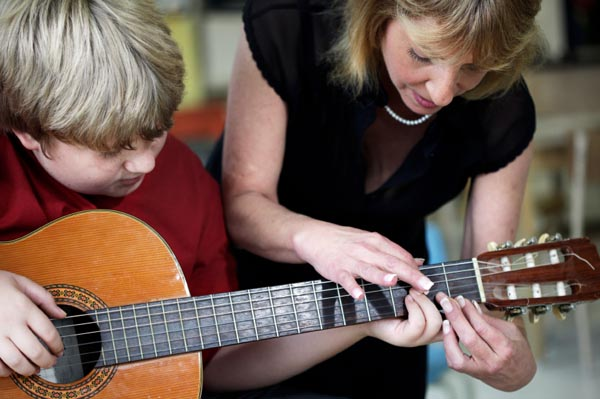 child-taking-music-lessons