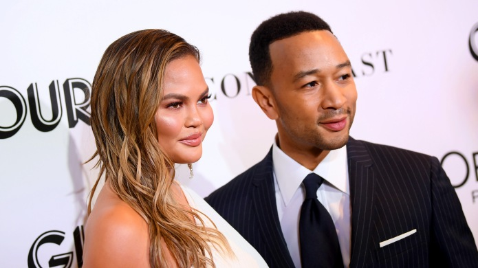 Chrissy Teigen and John Legend attend