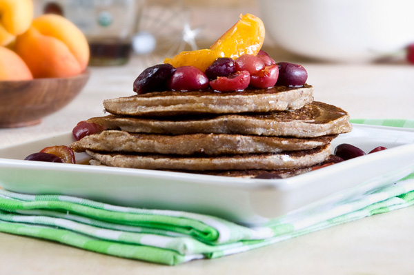 Coconut pancakes with roasted fruit topping