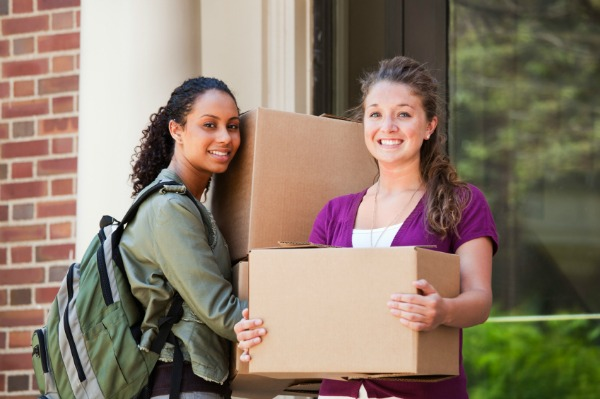 two college girls moving into dorm