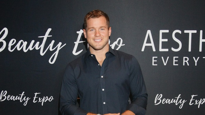 Colton Underwood poses for photos on