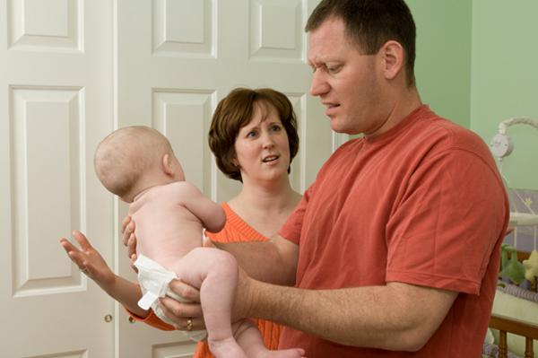 Dad changing diaper