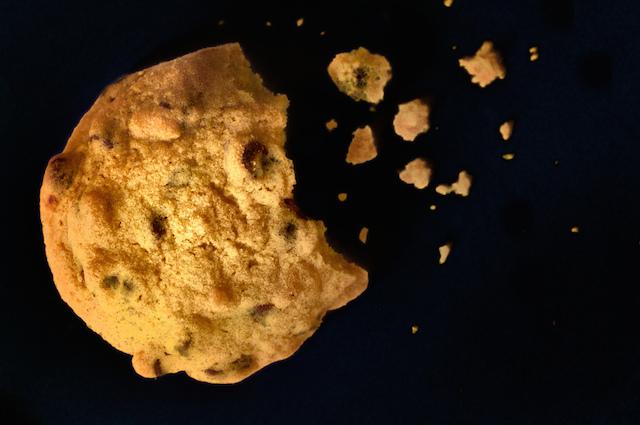 broken cookie with crumbs