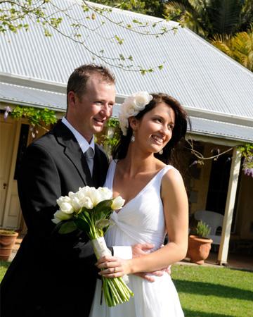 Couple in backyard wedding
