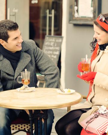 Couple having Christmas tea