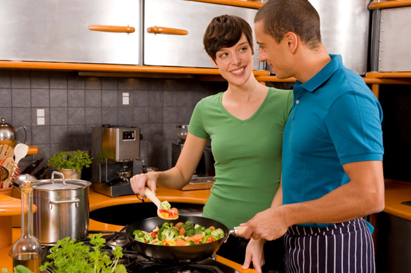 Couple cooking vegetables
