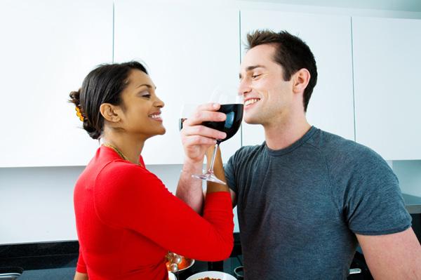 Couple flirting in kitchen