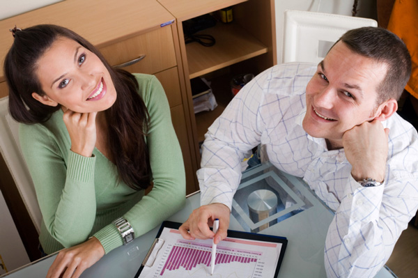 Couple going over spreadsheet