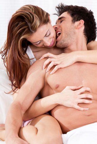 Couple playing on bed