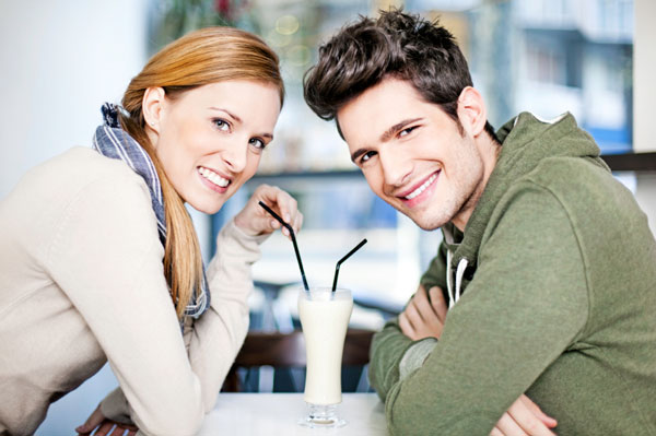 Couple on date sharing a milk shake