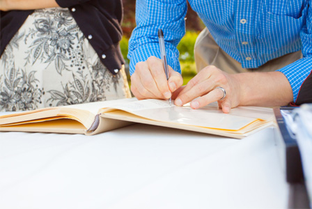 Couple singing guest book